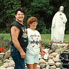 7/22/97-- statue of christ--Takaaki Iwabu photo-- Larry Jeffords and Bonnie Knepp decorate garden with the statue of Christ Larry found in junk yard. <br /> --Joan is confirming Bonnie's last name Thursday.... <br /> <br /> tmc photo
