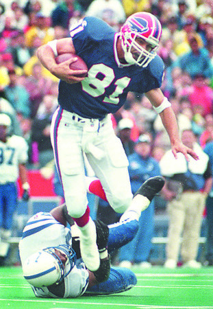 9/17/95--Bills' action2--Takaaki Iwabu photo--Bills' WR Bucky Brooks trys to espcape from Colts' defence after he caught a pass at Rich Stadium Sunday.