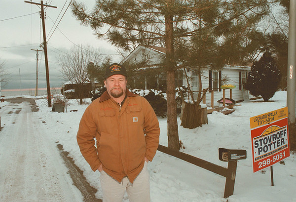 """98/01/22--PORTER SEWER WOES--DAN CAPPELLAZZO PHOT0--MIKE GILLIS, PRES. OF THE ROMBERG BEACH ASSN. STANDS IN FRONT OF HIS PORTER HOME, WHERE SEWERS WORK LIKE SHIT.<br /> <br /> ****EDS NOTE: TO GO"""" WITH MCBRIDE STORY***"""