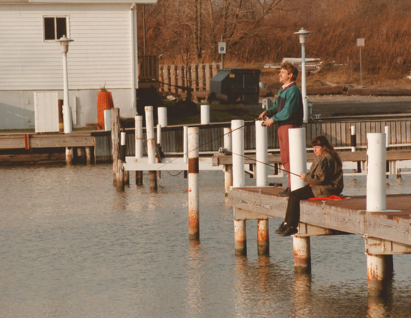 "98/01/05--WEATHER--DAN CAPPELLAZO PHOTO--RICHARD AND MARY LEVESQUE, OF N.F., ENJOY WARM WEATHER WHILE FISHING AT THE NT DOCKS OFF RIVER RD. THE COUPLE SAID "" SEEING THE WEATHER LOOK LIKE THIS WE JUST HAD TO GET OUT, "" ADDING  WE WERE GOIN TO BRING OUR ROW BOAT.""<br /> <br /> 1A"