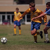 98/09/12 LHS Soccer vs West-Rachel Naber Photo-Paul Johnson of Locport Lions competes for the ball against Steve Lingle of West.