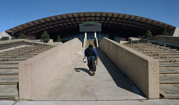 4/1/97---NFCC--DAN CAPPELLAZZO PHOTO--14-YR-0LD CHRIS MONTGOMERY DRIBBLES A BASKETBALL IN FRONT OF THE NFCC, THE CONVENTION CENTER WILL BE TAKEN OVER BY THE NEW DEVELOPERS.<br /> <br /> NEWS/1A
