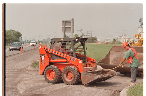 97/09/17 Parkway Work - James Neiss Photo - Local #91 Laborers L-R, John Spinks and David Slowik clean up debris in preparation for the paving of the Robert Moses inner lanes.