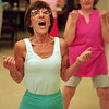 98/05/20 Local Vol 1-Rachel Naber Photo-As a volunteer fitness instructor Fran Rosati challenges the seniors to push and keep up with her.