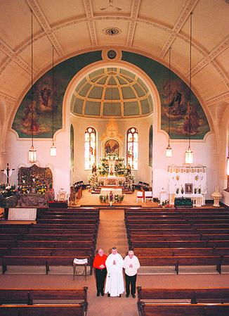 4/10/97--HOLY TRINITY/RELIGION--DAN CAPPELLAZO PHOTO--(LTOR)PARISHIONERS ELTON TRURMER (LEFT) AND LOUIS SKIBA (RIGHT) FLANK HOLY TRINITY DEACON WALTER M. FUDALA IN THE HOLY TRINITY CHURCH.<br /> <br /> FEATURE