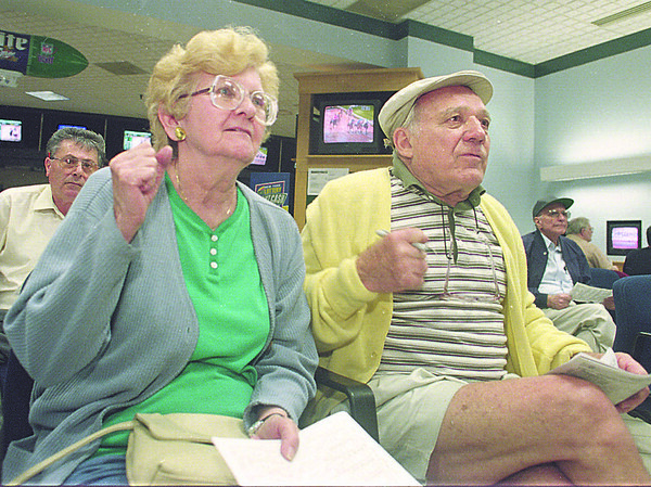 6/14/97-- otb--Takaaki Iwabu photo-- Sophia and Paul Peunic cheer the horse they bet at OTB in Rainbow Mall Saturday. The couple enjoy horse-race betting twice a week. <br /> <br /> Sunday, Sports, colr.