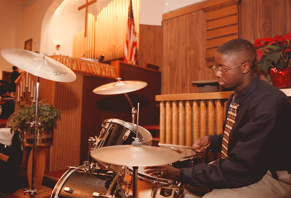 98/01/19--DRUMMER BOY--DAN CAPPELLAZZO PHOTO--NICK DOBBS, OF  EMMUAL TEMPLE,  BEATS THE DRUMS AT THE TRINTY BAPTIST MLK CELEBRATION.<br /> <br /> GR