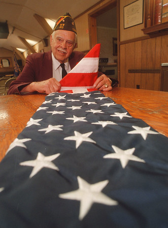 6/16/97 Flag Care - James Neiss Photo - Justin Bayne, Sr. Vice Commander of the Youngstown VFW Post, gives tips on Proper Flag Presentation and Care Friday Nights at the Youngstwon Gazebo.