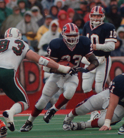 97/11/02 Bills VS Miami 2 - James Neiss Photo - Bills #23 Antowain Smith runs with the ball as Bills #10 QB Alex Van Pelt looks on. Miami 93 Trace Armstrong tries to make the stop in the 2nd Qtr.