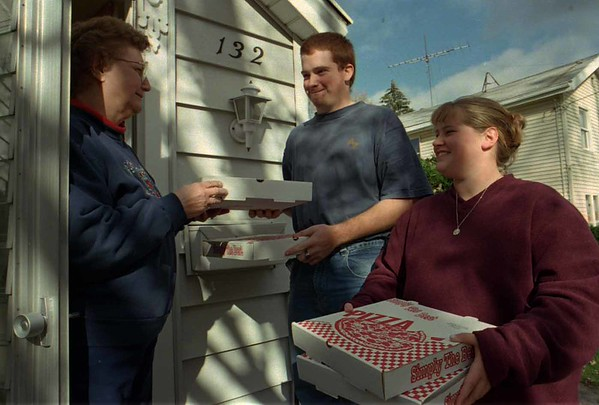 98/11/04 Pizza,Pizza *Dennis Stierer Photo<br /> Lockport High School Band Members, Sean Hickey and Theresa Jones (center and left) practice their Piza selling style on Bernice Sheldon for the upcoming Fundraiser on Saturday which begins at 9:30AM.