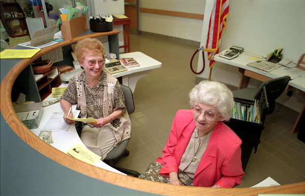 98/05/20 local Vol 3-Rachel naber Photo-Seniors are greeted by volunteers Marion Koah (left) and Jean Thourling at the front desk of the Lockport Senior center.