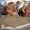 98/07/25 Barker Corn Fest4-Rachel Naber Photo-Sarah Scott nibbles on an ear of roasted   corn with her family at the Barker Corn Festival.
