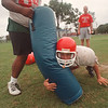 97/08/29 NFHS Football - James Neiss Photo - L-R - Niagara Falls High School Football - Lawrence Colvin holds the bag for Bryan Casal as they practice Defensive Lineman Goal line drills under the watchfull eye of Coach James Spanbauer.