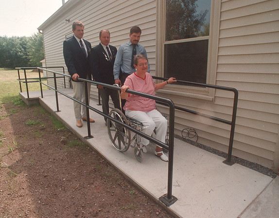 97/08/25 Wheel Chair Access - James Neiss Photo -  The Ransomville Lions donate access ramp for disabled to Historical Building behind the Ransomville Free Library. L-R are, Roger Curry Lions Treasurer, Gene Cevaer, Ramp Committee Chair, Mark Roberts president of Lion and Sue Holmes, Director of the Ransomville Free Library.