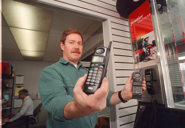 2/6/97 Cellular Phone - James Neiss Photo - Mark Oliphant, of Cellular Systems on Millitary Road shows off some of the Cell phones.