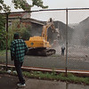 97/09/12-- Demolition--Takaaki Iwabu photo-- A passerby watches the demolition of the building on 13th and Cleveland Ave. Friday. <br /> <br /> Nowhere in budget.... saved in Takaaki Daily Scan with RGB, raw color