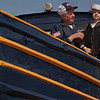 "98/04/23 CAP-RACHEL NABER PHOTO-CHARLIE WINTERS AND ""CAP"" HAVE BEEN IN DRY DOCK SINCE A DISPUTE WITH THE CITY OVER WHERE WINTERS CAN PARK THE TUG BOAT  WITH CAP AT THE WHEEL TO GREET TOURISTS."