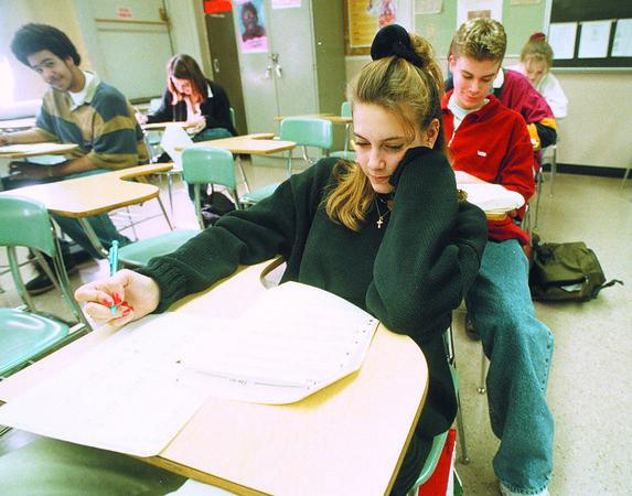 1/21/97 School Reportcard 3 - James Neiss Photo - Alexis Korpolinski 16/11th works on a health test at NFHS Niagara Falls High School.