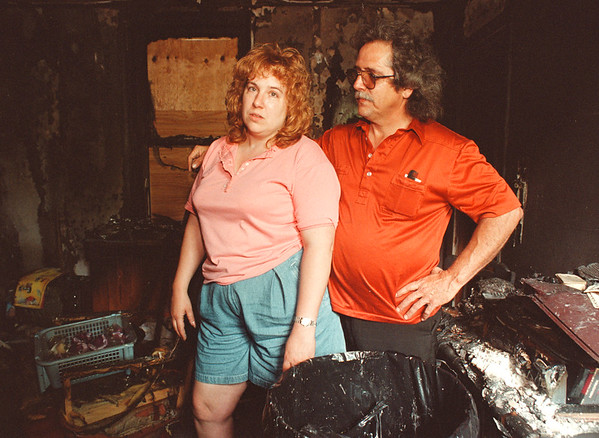 6/17/97-- burned house--Takaaki Iwabu photo-- Mary and Harry Craft stands in their house on 461 5th St, which was burned by a fire Saturday. <br /> <br /> 1A, Saturday