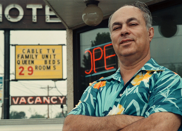 97/08/16-- Motel --Takaaki Iwabu photo-- Joe Dakwar, owner of Sharon Motel on Niagara Falls Blvd., stands in front of his motel's billboard which signs a low rent-price for rooms in the middle of  the tourist season. <br /> <br /> Monday, 1A, color