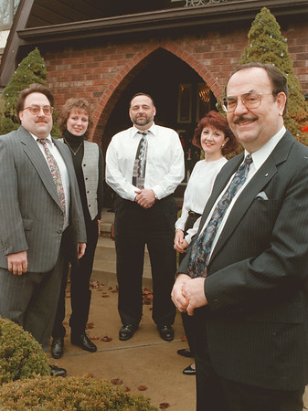98/01/07-- K-mart --Takaaki Iwabu photo-- A family portrait of Hinkles, whose members all worked or work for Kmart in Niagara Falls. Pictured from left, Mark, Rene, Rick, Mary and Dick Hinkle, front right. <br /> <br /> bw, feature, Monday (with promo)