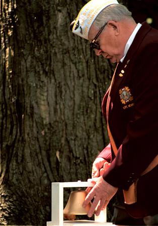 98/05/25 Ft. Niagara Memorial-Rachel Naber Photo-Ross Pierce tolls the bell at Ft. Niagara Memorial Day service to remember fallen comrads.