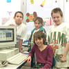 "98/04/01 Multimedia Kids *Dennis Stierer photo - On March 17th these students from Mrs. Karen Schlum's LAC class participated in the Orleans-Niagara Teacher Resource Center's 10th Annual Computer Fair. The students, Laaura Densmore (sitting), and standing from left, Andy Wruck, Cheryl Flagler, and Steven Berning did a HyperStudio Multimedia project called ""Oh The Places They Go! Oh The Clothes They Wore! What Animals"", which was based on an ABC rhyming book that the class wrote."