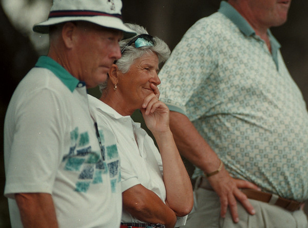 98/07/23--P Cup --Takaaki Iwabu photo-- Gert Kennedy, middle, observes the 18th-hall play with her husband Mark during the second day of the 40th Porter Cup at Niagara Falls Country Club. The annual golf tournament draws many local golf fans. GRAPEVINE PHOTO