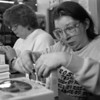1/21/96-- Opp. Unlimited 1--Takaaki Iwabu photo-- Donna Burton, right, seals the boxes of chocolate with Karen Hurtt at Oppotunity Unlimited in Niagara Falls. (story on annual State-wide fund raising by O.U.) <br /> <br /> local, Wednesday