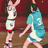 1/27/97--GIRLS HOOPS--DAN CAPPELLAZZO PHOTO--GRAND ISLAND'S BETH DIETRICH (RIGHT) GOES UP TO BLOCK A SHOT BY NW'S _______________ IN FIRST HALF ACTION AT NW.<br /> <br /> SP