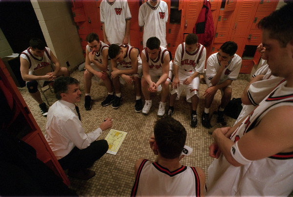 98/02/18 Stpt@Wilson3 - James Neiss Photo - Wilson Varsity Boys Basketball Coach Pete Reagan goes over the game plan for the second half against Starpoint.