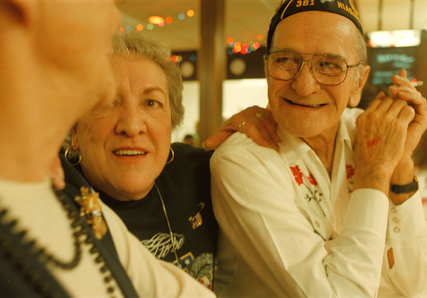 98/03/08--Jamboree--Takaaki Iwabu photo-- Carol Dyson and Dick Pendleton share a laugh as they exchange story with Lillian Pendleton (picture front left) during the annual jamboree at American Legion/John J. Welch Post 381 on Niagara Ave. Sunday. Nearly 300 people gathered for fun and raised fund for Children's Hospital in Buffalo. <br /> grapevine photo