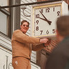 98/02/03-- landmark clock--Takaaki Iwabu photo-- Jay Soemann of Walker Bros. & Monroe Jewelers installs an outdoor street clock in front of his store Tuesday on Webster Street in North Tonawanda. (more info on the attached press release..) <br /> <br /> 3A, bw, Thursday with extended caption or Grapevine