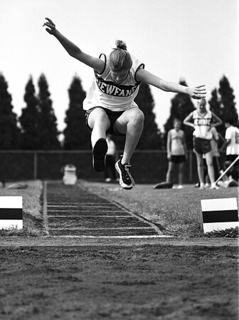98/05/19 CNTY Track2-Rachel Naber Photo-Jacki Banks of Newfane propels herself forward in the long jump at the county track meet held at Barker High School.