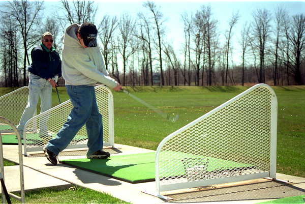 98/04/10 ENT Eagle Golf-Rachel Naber Photo-Christopher Lavocat (right) and family friend Judy Dingeldey(left) chip golf balls at Eagle Crest Golf range on Transit road.