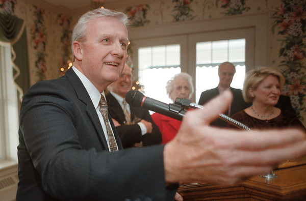98/1/2 David Broderick - Vino Wong Photo - David Broderick gestures to the crowd after being sworn in as the re-elected county treasurer at the Niagara Falls Country Club Saturday.