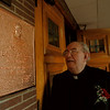 98/05/27 Edward Scanlan - James Neiss Photo - Monsignor Edward J. Scanlan looks at a newly erected plaque in his honor at Mt. Carmel School. He is celebrating 45years of service.