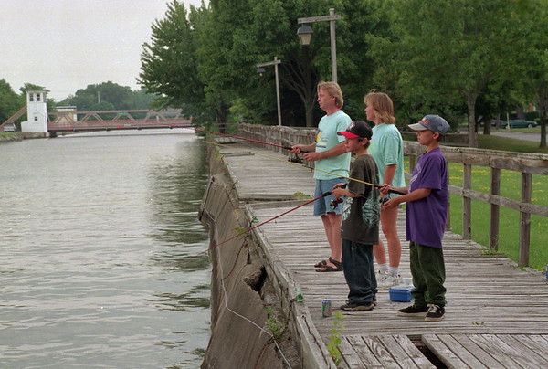 98/07/30  Canal Fishing *Dennis Stierer Photo -<br /> Mark Havens and Stephanie Koch (in light colored shirts in background) took their children David Koch,11 and Chris Havens,11(right side) fishing down by the canal  off Market Street.