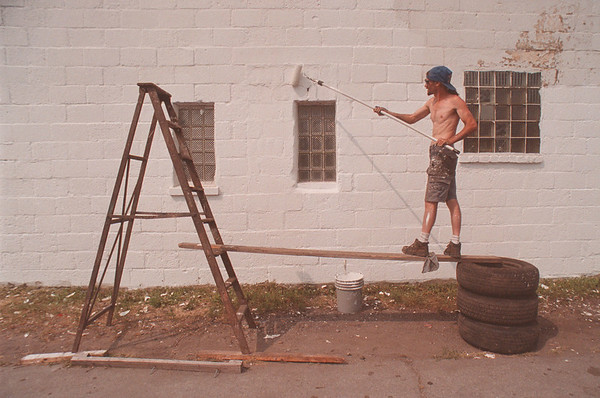 """97/08/10 Painter - James Neiss Photo - Sprucing up the Neighborhood,  Roy Morrison of South Ave. was hired to paint the""""Pee Dee Auto"""" building on 11th street."""