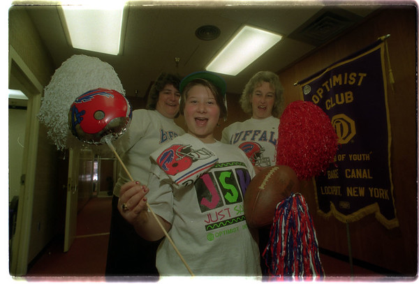 """97/11/18 Optimist Bills Bash - James Neiss Photo - The Canal Optimist Club to hold Bills Bash. L-R are: Clara Tilney, Party chairman, Deanna Turco 11yrs of Lockport, a """"just say no"""" program participant and Pauline Leacock, Prsident of the Barge Optimist Club."""