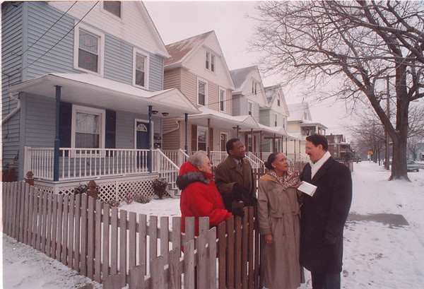 2/11/97 Housing - James Neiss photo - Alstate Donates money for housing -  L-R - Christine LaSalle, President of the Presti Tennant Association and a Member of the Niagara Housing board, Larry Webster, Alstate Neighborhood office Agent, Annie Fields-Chapman, General manager/Director community Services for the Niagara Falls Housing Authority and Mark Montazzoli, Allstate Agency Manager outside of a row of ReHab housing on Walnut Ave.