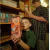98/05/06 Video Library - James Neiss Photo - L-R - John Bergey, Jr. 7yrs/1st grade and Nicholas Lupo 13yrs/7th grade look over some of the new videos for use at the St. Paul Lutheran school.