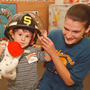 97/10/07--PRE-K FIRE KIDS--DAN CAPPELLAZZO PHOTO--3-YR-OLD TYLER SCHEVING, OF ST JOHNS LUTHERIAN SCHOOL, WARD RD, TRIES ON A FIRE HELMUT WITH THE HELP OF SHAWNEE FIRE CO. MEMBER  MICHELLE SINGLETON AT THE PRE -K FIRE PRERVENTION CLASS.<br /> <br /> ECHO