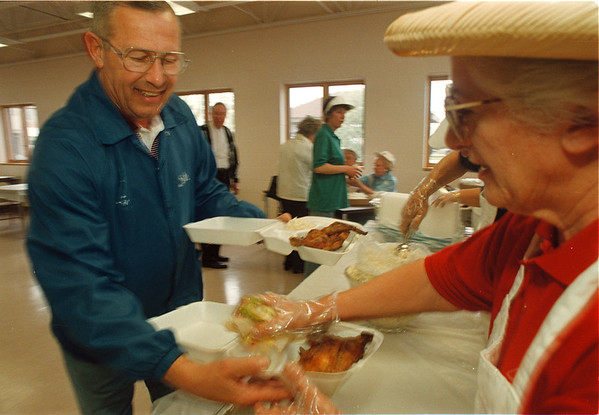 5/29/97 Chiavetta's 2-- Takaaki Iwabu photo-- Pete Fatouros of Town of Niagara was the first in the line for the Chicken dinner served at John Duke Senior Center (as part of Community Fair.)<br /> <br /> local, Friday