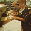 7/14/97 Vote Petitions 2 - James Neiss Photo - L-R - Mary Ann Casamento, Deputy Commissioner and Suzanne Chank, Clerk, go over campaign petitions submitted to the Niagara County Board of Elections.