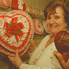 98/01/26-- valentine day 1 --Takaaki Iwabu photo-- Lillian Marchioni, owner of Temptations Candy & Gift, holds a box of 2-pound chocolate, which is wrapped by fancy lace. The store also sells simple and small box of chocolate, picture right. <br /> <br /> Sunday, feature, color