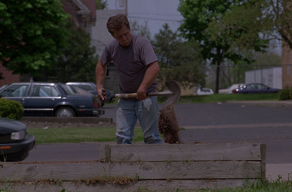 5/28/97--LANDSCAPING--DAN CAPPELLAZZO PHOTO--CATHOLIC WORKER VOLUNTEER DAVID WINSOR BREAKS GROUND ON AN HERB GARDEN NEXT TO THE CATHOLIC WORKER. THE HERBS GROWEN IN THE GARDEN WILL BE USED IN THE KITCHEN AT THE NIAGARA STREET CHARITY ORGANIZATION.<br /> <br /> GRPAPE