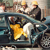 9/14/97--NFB/59TH ST.ACCIDENT--DAN CAPPELLAZZO PHOTO-- METRO AMBULANCE AND NF FIRE FIGHTER WORK TO  FREE AN ACCIDENT VICTIM FROM HER CAR WHICH WAS INVLOVED IN A HEAD ON COLLISION. TWO OTHER VEHICLES WERE INVOLVED IN THE AFTERNOON ACCIDENT AT THE CORNER OF NFB AND 59TH ST.<br /> <br /> 1A NEWS
