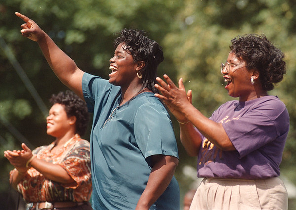 97/08/30 --Gospel Fest 2--Takaaki Iwabu photo-- Cynthia Feagin, center, and Minister Joyce Sconiers, right, both from Higher Ground Christian Center, express their emotion during the Gospel Festival at Gluck Park. <br /> <br /> local, Sunday, color