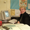 98/01/22 School Nurse*Dennis Stierer photo - Mrs. Ann Graham, a school nurse for ten years at John Pound Elementary School enjoys the new computer for keeping records.